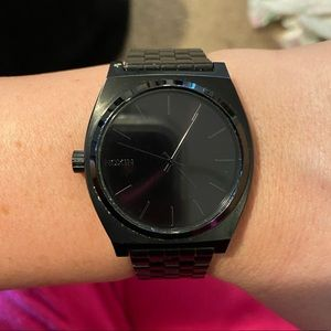 "Nixon ""time teller"" watch"